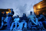 Fans watch a video parodying President Bush during Green Sunday at Red Rocks in Morrison on...