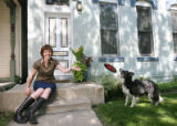 "Home Front story about Jennifer Roberts, outside with her dog, Abby. It's part of our ""Open..."