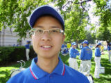 Abraham Hu, Falun Gong protester at Civic Center Park on Aug. 25, 2008. Photo By, Reporter, Steve...