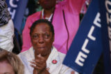 Luella McQueen, a delegate from Jacksonville, Fla. gets emotional during keynote speaker Michelle...