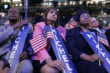 Illinois delegates Jesse White, left, Iris Martinez,  center, and Connie Howard, right, listen to...