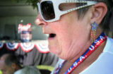 (021)  Connie Truax of Golden reacts to a friend as volunteers and supporters of the Minuteman...