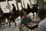 Tim Fortney,(cq) left, and Bill O'Neil(cq) play chess on 16th street on Monday, Aug. 25, 2008  in...