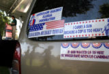 (142)  Stickers on a car belonging to one of the volunteers and supporters of the Minuteman Civil...