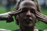 Amanda Hubbard, of Denver, rubs her eyes after she was pepper sprayed by police. Protesters...