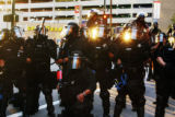 Police surround protesters near 15th and Court Streets on Monday, August 25, 2008.  Police pepper...