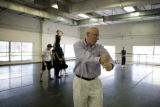 Choreographer Peter Anastos (cq) of Ballet Idaho demonstrates how he wants an act performed to...
