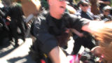 Denver police knocked down Code Pink protester Alicia Forrest  (cq)using a baton across from the...