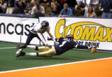 Denver, Colo., photo taken May 30, 2004- Colorado Crush  offensive safty, Damian Harrell (right)...