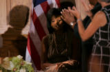 Michelle Obama receives an applause for her opening night speech at the DNC with the shadow of...