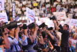 The throng of media during the Democratic National Convention on Tuesday, August 26, 2008, at the...