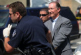 Pastor Lee Hartley is arrested by police outside The Pepsi Center after he and others from...
