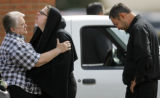 (from right) 36 year-old Vito Kudlis (cq) and his wife, Eneily Kudlis (cq), 33, are comforted by...