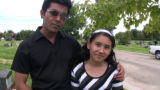 Nimra Bukhari, 10, with her father, Aamer Bukhari, following a funeral service for her friend,...