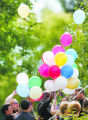 Family and friends gather balloons to release after 3 year-old Marten Kudlis (cq) is buried at...