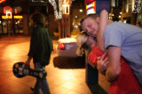 James Calhoon, 24, (cq) of Mississippi hugs Alana Byrnes, 26, (cq) outside the Appaloosa Grill at...