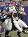 Jeb Putzier runs with the ball in the first half of the Denver Broncos against the New York Giants...