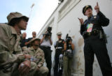 "Deputy Chief of Police, John Lamb (cq) talks to the organizers of ""Iraq veterans against the..."