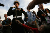 Democracy Now's host, Amy Goodman (cq) (at lower right) holds a microphone up to Lance Corporal...