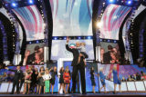 Democratic vice-presidential candidate Joe Biden waves to the crowd after presidential candidate...