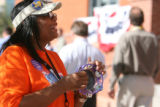 Volunteer Gloria Lee of Texas plays the tambourine as delegates, volunteers, special guests, and...