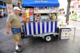 Boris Lerman(cq) tends to his hot dog stand located on the 16th Street mall and Stout St....