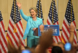 Hillary Clinton waves to her delegates in a meeting in which she released them in the Denver...