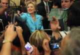 Hillary Clinton greets her delegates after releasing them during a meeting in the Denver...