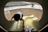 (062) DeChawune Edwards, 4, climbs up a slide during the playground time Tuesday, August 26, 2008...