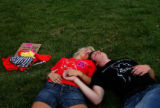 (PG1370) A couple gets some rest after a march from the Denver Coliseum to the Pepsi Center on...