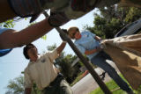 (235) Wyoming delegate Nancy Drummond, right, works planting a tree under the supervision from Ken...