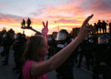 (287) Police stands firmly protecting a perimeter around the Pepsi Center Wednesday, August 27,...