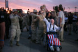 (326) Ron Kovic, a Vietnam vet, leeds a group of veteran protesters in cheering Wednesday, August...