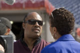 Stevie Wonder talks with Robin Roberts of Good Morning America at Invesco Field as preparations...