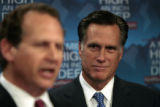 Former governor Mitt Romney, right, listens to U.S. Rep Lincoln Diaz-Balart, speek to the media,...