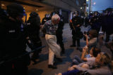 Cecil Bethea, 80, (cq) is restrained by Denver Police after being group after being surrounded by...