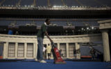 Eddy Jefferson vacuums the stage as preparations for Thursday's speech by Barak Obama were...