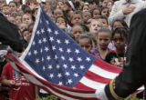 Students watch as an American flag is raised, Thursday morning, September 11, 2008, Jewell...