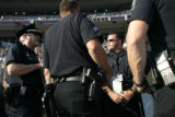 Westminster Police Department officers plan their strategy of coverage at Invesco Field at Mile...