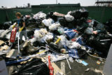 CSU students sort through 3 days of trash outside of the Pepsi Center ,Thursday, Aug. 28,2008. The...