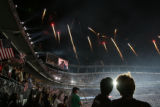 People in the stands watch the fireworks after Barack Obama's acceptance speech the last day of...