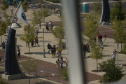People make their way into Invesco Field on the final day of the Democratic National Convention,...