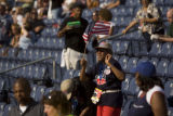 Wilhelmenia Golden of Macon, GA., dances during the opening activities in Invesco Field on the...