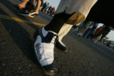 Wan Ali shows off his Obama shoes while in line with people already in their seats those in the...