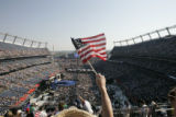 Kathy Fauth, of Elizabeth, Colorado, waves a flag from the 5th level during the final day of the...