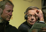 Long time football radio announcer, Larry Zimmer (cq),right, looks at the University of Texas...