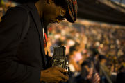 Steven Cummings of Washington, D.C., takes a picture of the opening activities in Invesco Field on...