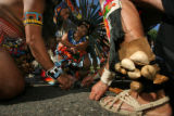 "Members of ""Grupo Tlaloc"", an Aztec dance group burn sage brush to bless an immigrant..."