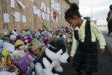 Lydia Wilson, 5, (cq) touches a teddy bear at a memorial of stuffed animals in remembrance of...
