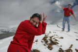 Brent and Audra Wilson (cq) of Moore, Oklahoma, throw snowballs on top of Loveland Pass Friday...